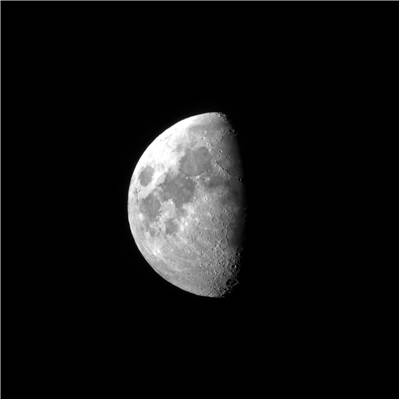 Picture Of Half Moon Seen From A Small Telescope