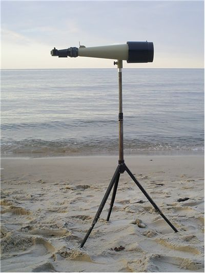 Picture Of Old Telescope On Beach
